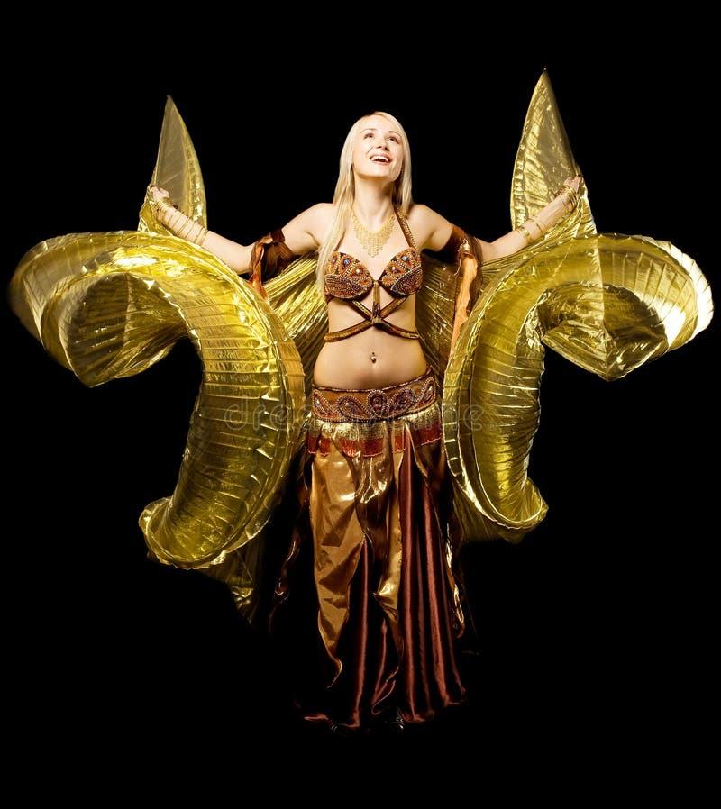 piękna tana dziewczyny złota skrzydło obrazy royalty free