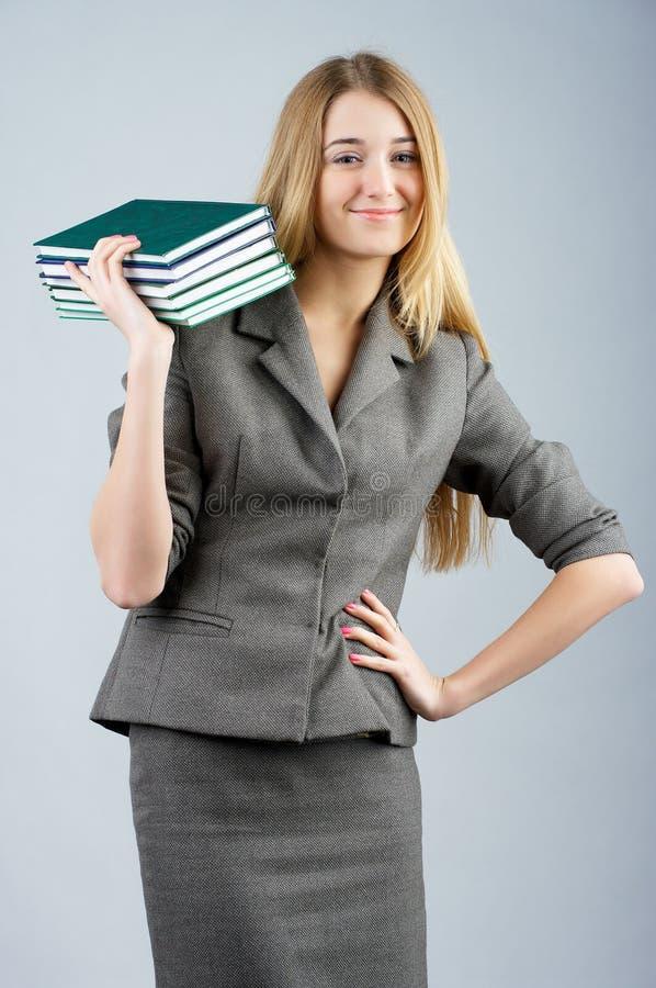 Biznesowa kobieta z z stosem zdjęcie royalty free