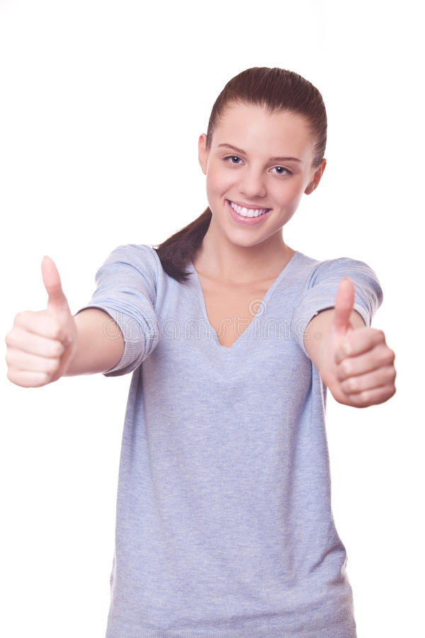 Piękna uśmiechnięta kobieta z aprobatami na dwa ręce zdjęcia stock