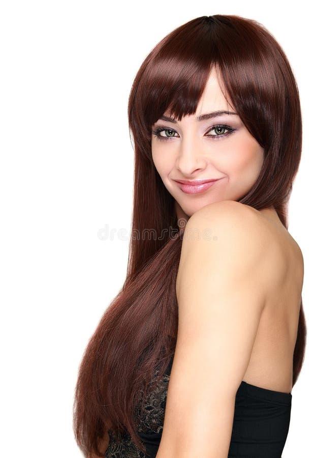 Piękna uśmiechnięta kobieta z długie włosy patrzeć fotografia royalty free