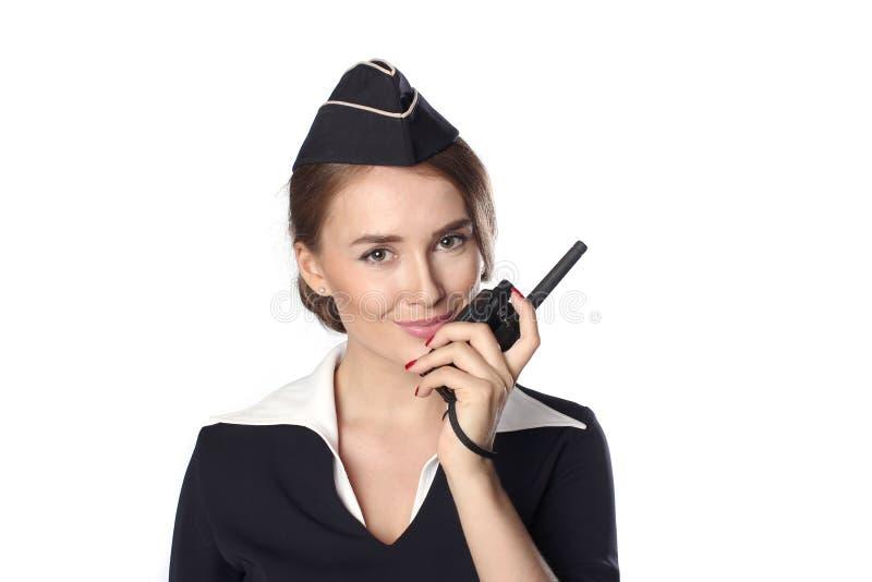 Piękna uśmiechnięta stewardesa odizolowywająca na białym tle fotografia royalty free