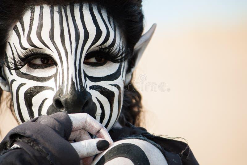 Piękna zebry kobieta obraz stock