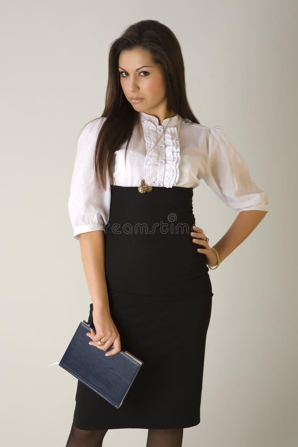 piękne dziewczyny obrad gospodarstwa interes strój obrazy stock