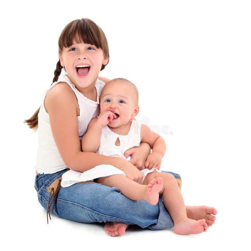 piękne szczęśliwe siostry zdjęcie stock