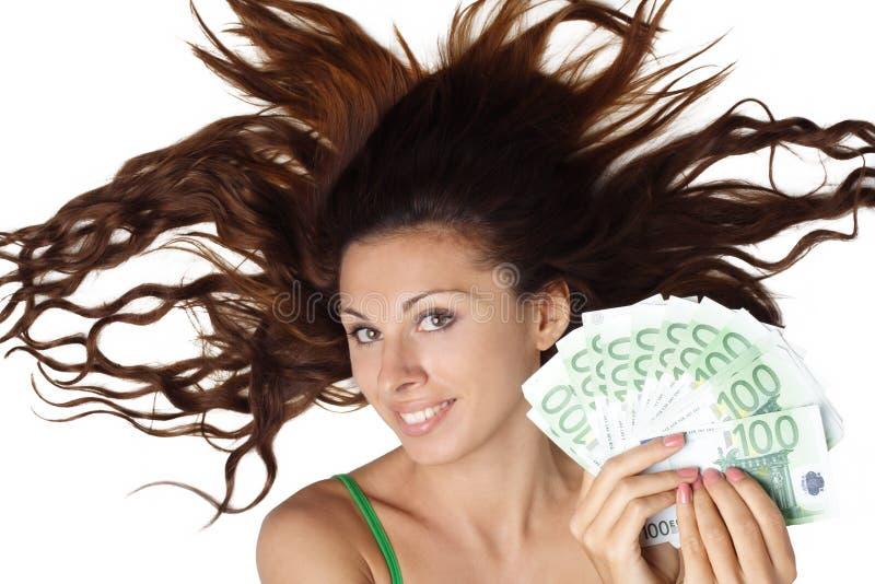 pięknego euro chwyta łgarska pieniądze kobieta fotografia royalty free