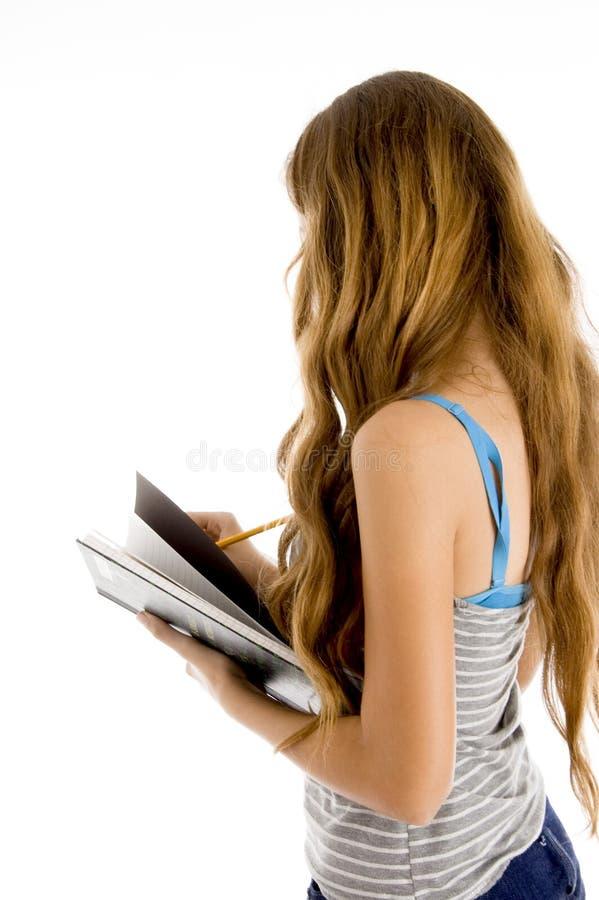pięknego notatnika studencki nastolatka writing zdjęcia stock