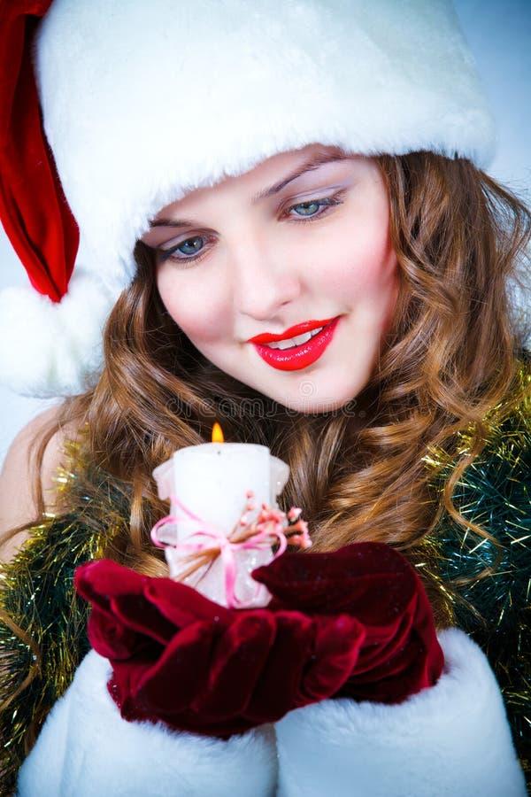 pięknej świeczki kapeluszowa Santa kobieta obrazy royalty free