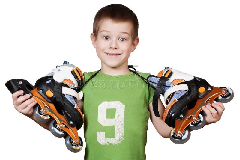 pięknej chłopiec małe rolkowe łyżwy zdjęcie royalty free