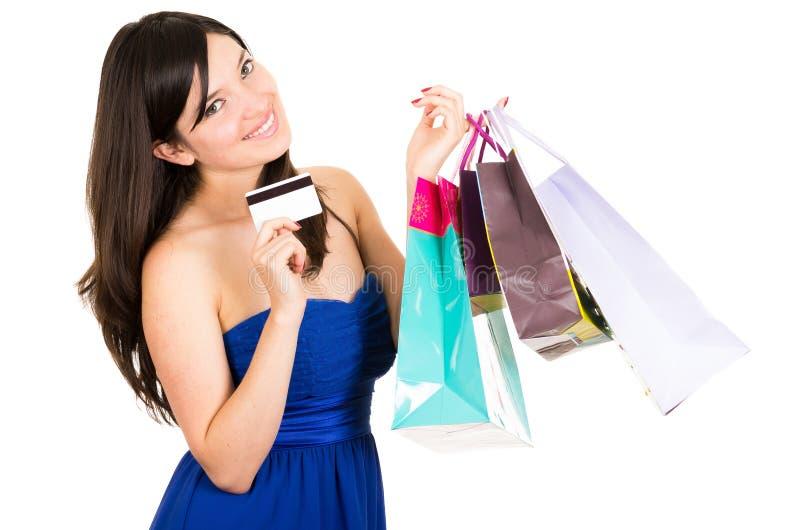 Pięknej młodej brunetki kobiety uśmiechnięty zakupy zdjęcie stock
