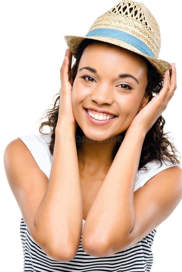 Pięknej mieszanej biegowej kobiety uśmiechnięty portret odizolowywający na białych półdupkach obrazy royalty free