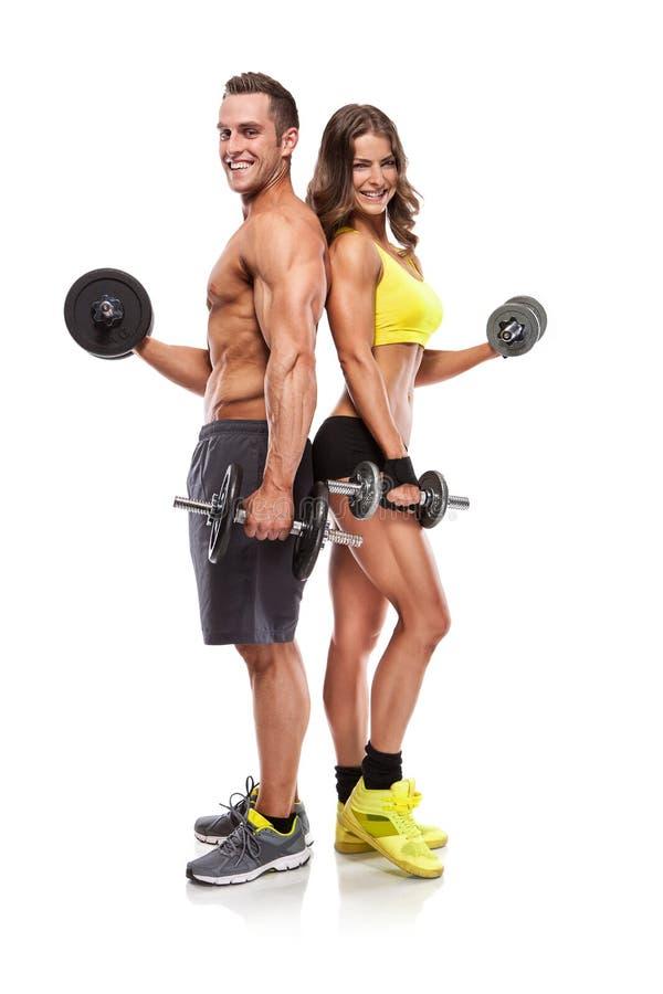 Pięknej sprawności fizycznej młoda sporty para z dumbbell fotografia stock