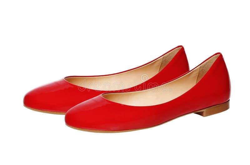 Piękni czerwoni kobieta buty odizolowywający na bielu obrazy stock