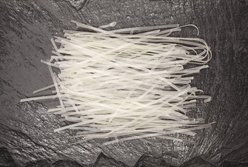 Piękni domowej roboty Japońscy ryżowi kluski od durum banatki na kamiennym tle, zbliżenie obrazy stock
