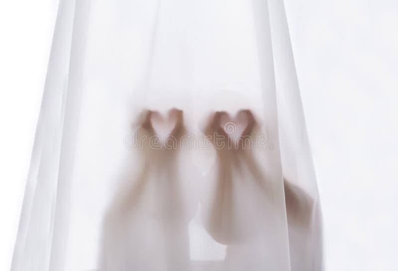Piękni serca robić od ręk, z ciepłym lekkim jaśnieniem przez zasłony zdjęcia stock