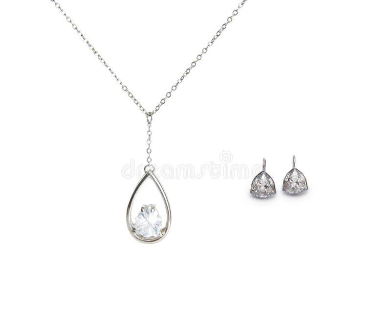 Piękni srebni kolii i diamentu kolczyki odizolowywający na bielu zdjęcia royalty free