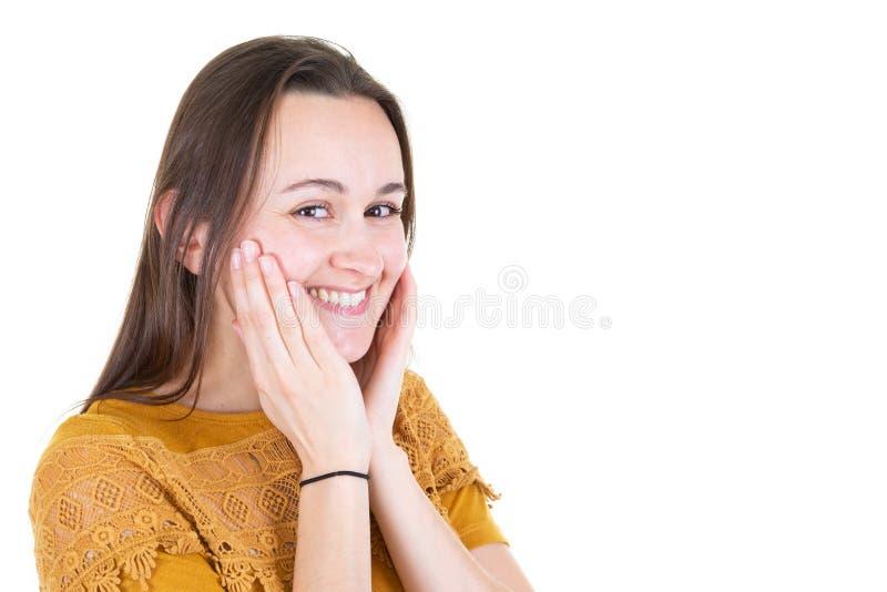 Piękno kobiety biały uśmiech z rękami na policzkach obraz royalty free