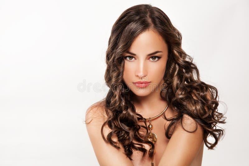 Piękny brown kędzierzawy włosy obraz royalty free