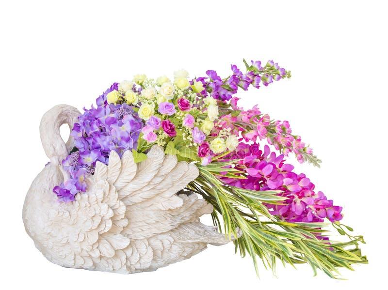 Piękny bukiet kwiaty w łabędź wazy statuach obrazy royalty free