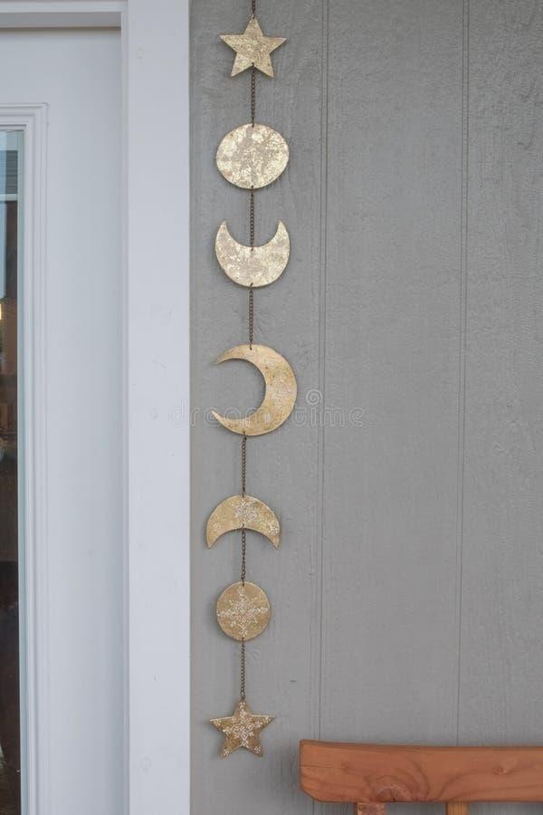 Piękny dekoracja kawałka składać się z księżyc, słońca i gwiazdy, zdjęcie stock