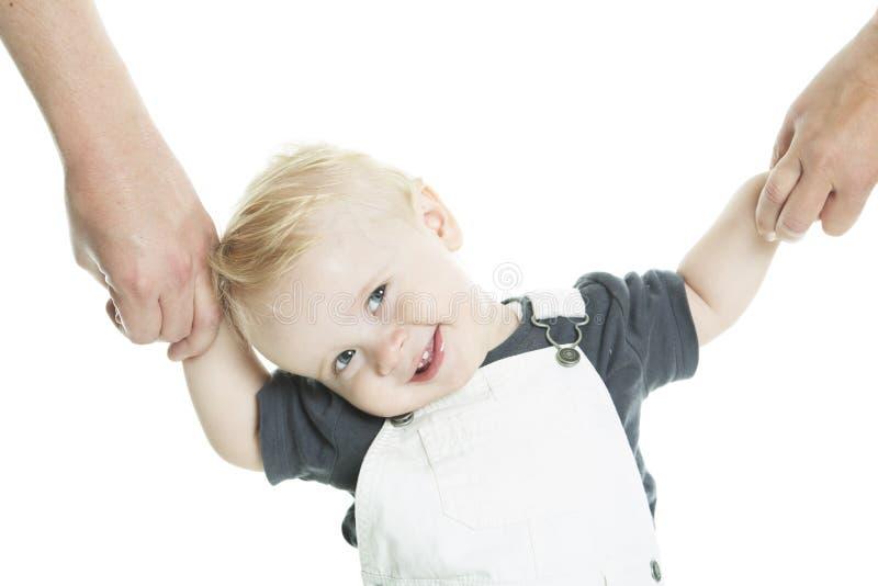 Piękny dziecko uczenie chodzić odosobnionego na a fotografia stock