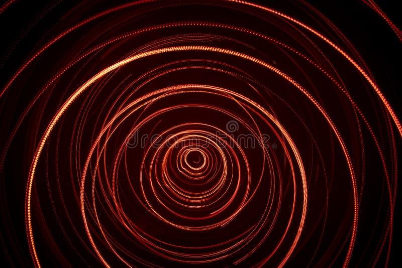 Piękny, jaskrawy lekki zawijas czerwony kolor, Futurystyczny lekki obraz na czarnym tle zdjęcia stock