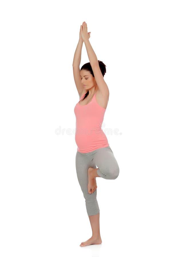 Piękny kobieta w ciąży robi joga obraz stock