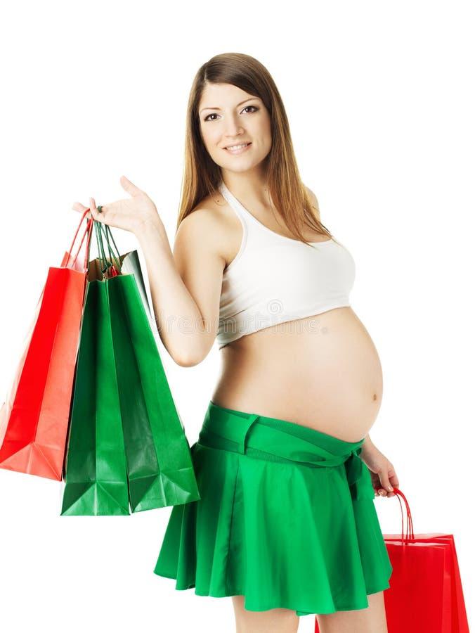 Piękny kobieta w ciąży z torba na zakupy fotografia royalty free