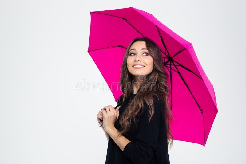 Piękny kobiety mienia parasol i przyglądający up zdjęcia royalty free