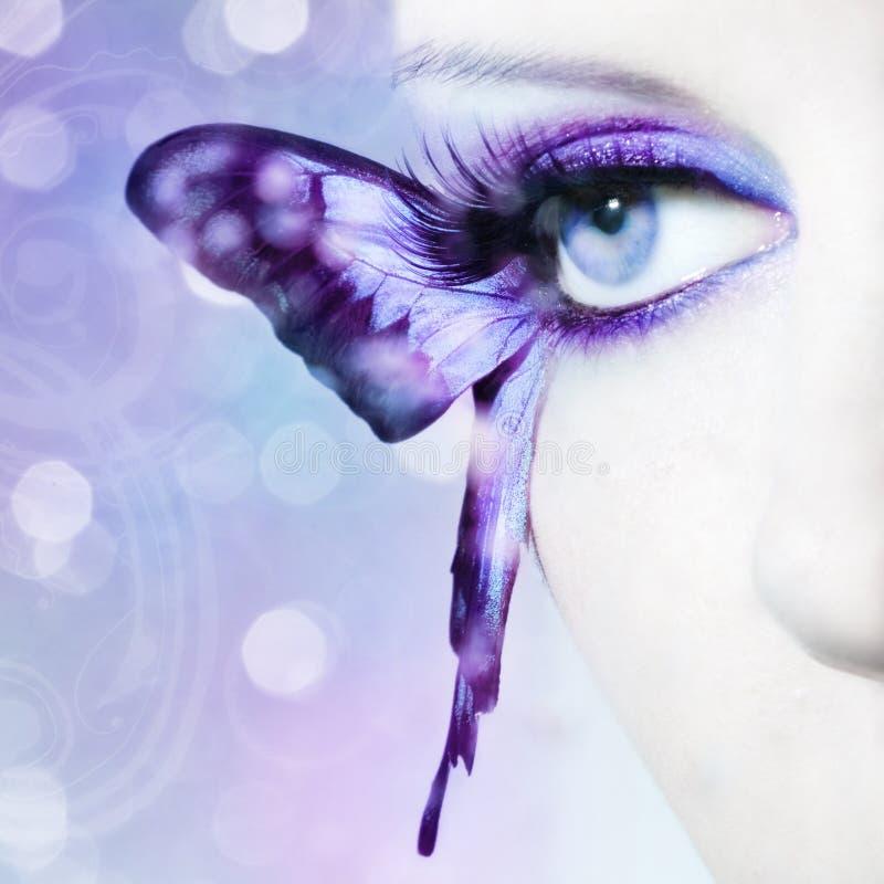 Piękny kobiety oka zakończenie up z motylimi skrzydłami zdjęcie royalty free