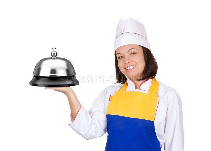 Piękny młoda kobieta szef kuchni z Dużym Usługowym Bell obraz stock