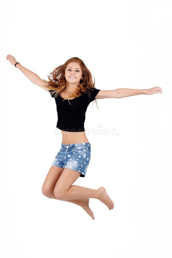 Piękny nastolatek dziewczyny doskakiwanie, biegać odizolowywam obrazy royalty free