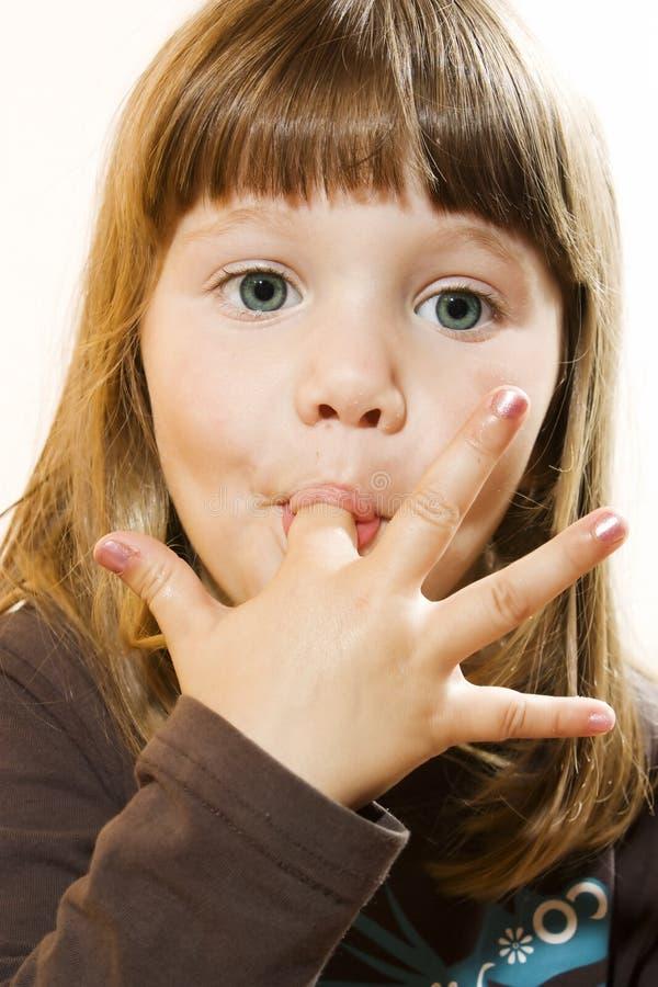 piękny palców dziewczyny oblizanie trochę zdjęcia stock