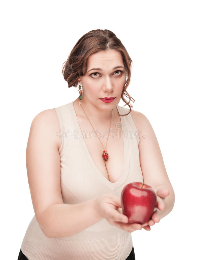 Piękny plus wielkościowa kobieta sugeruje jabłka obrazy stock