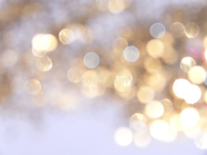 Piękny rozmyty złoty tło, świąteczny bokeh światło zdjęcia royalty free