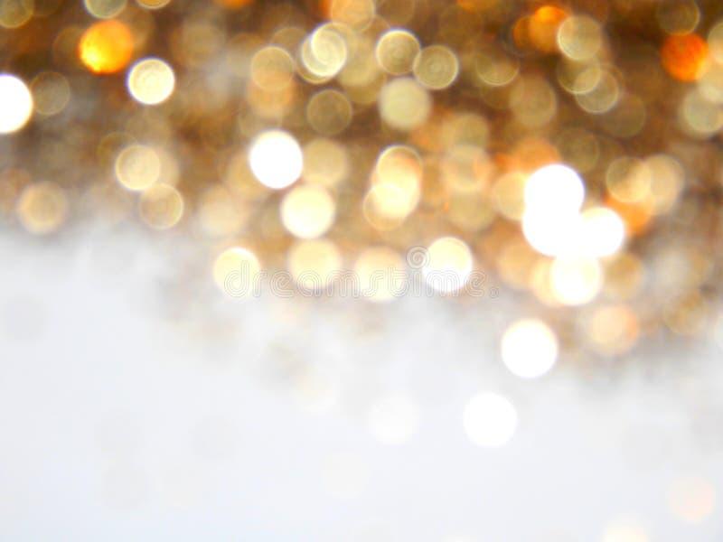 Piękny rozmyty złoty tło, świąteczny bokeh światło fotografia royalty free