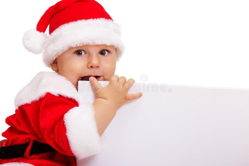 Piękny Santa chłopiec nadgryza majcheru kąt zdjęcie royalty free