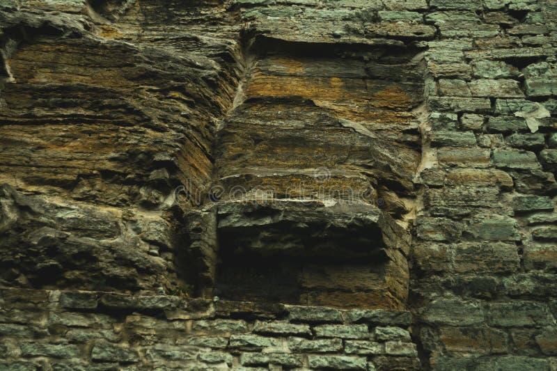 Piękny skalisty ścienny tło grunge abstrakcyjna konsystencja kamienny ściany z cegieł kamieniarstwo obraz stock