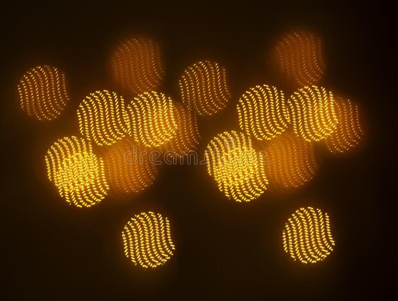 Piękny złocisty bokeh z wzorem geometryczni elementy na ciemnym tle fotografia stock