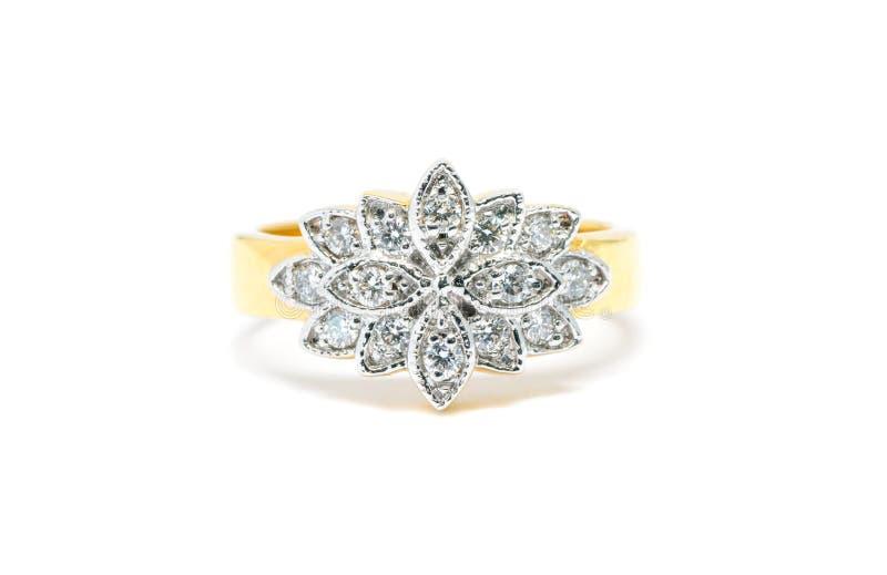 Piękny Złocisty pierścionek z diamentem odizolowywającym na bielu obraz royalty free
