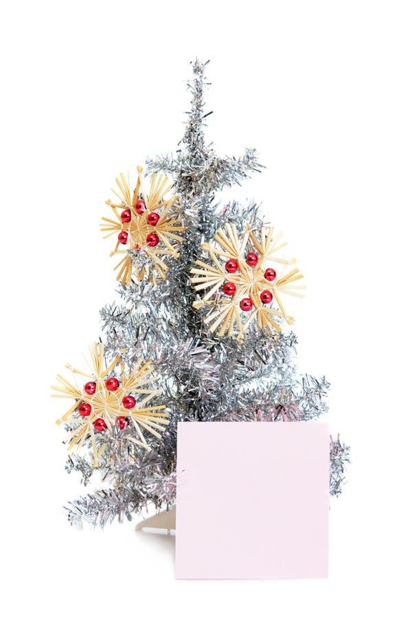 Piękny zabawkarski jedlinowy drzewo z zabawkami i majcherem zdjęcie stock