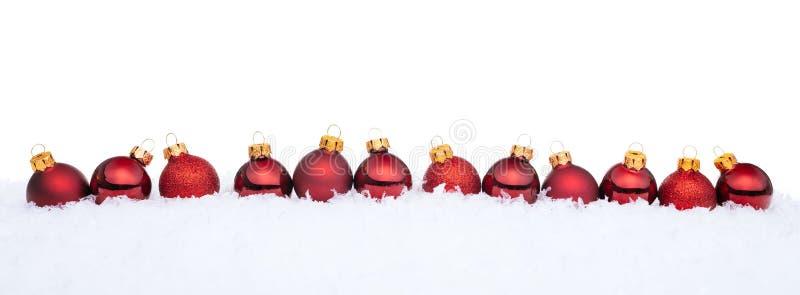 piłek bożych narodzeń czerwieni śnieg obraz royalty free