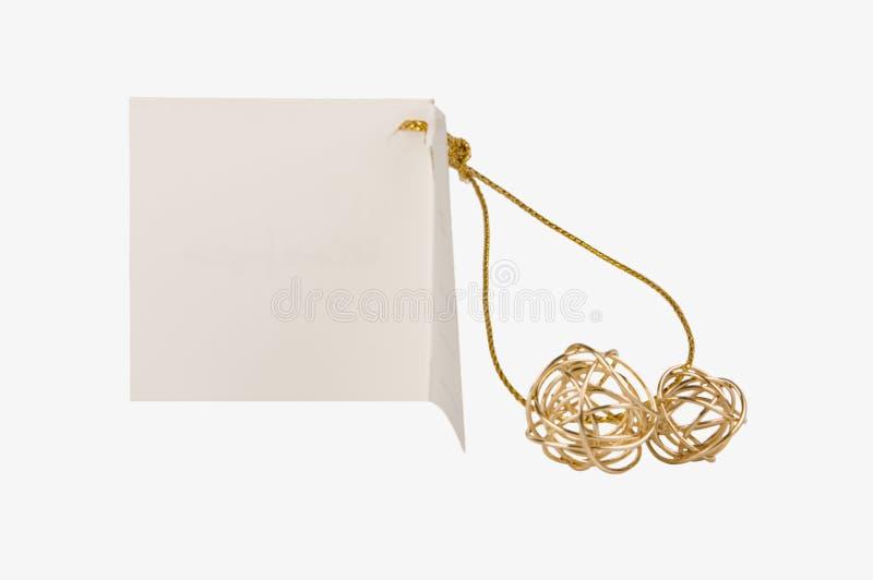 piłka daru etykiety złoty papier w izolacji obrazy stock