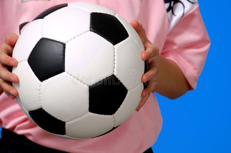 piłka futbolowa gospodarstwa fotografia stock