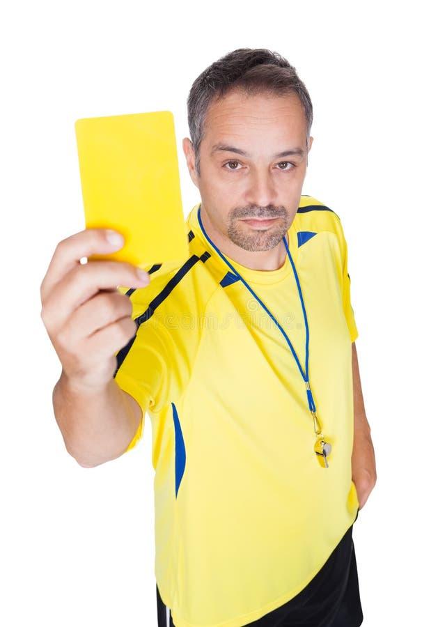 Piłka nożna arbiter Pokazuje żółtą kartkę obrazy royalty free
