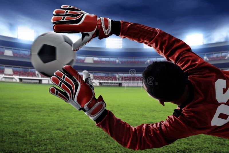 Piłka nożna bramkarza chwyt piłka zdjęcie royalty free