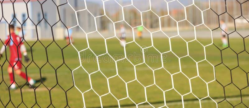Piłka nożna mecz futbolowy w arenie i sieci Zamazany gracza tło obrazy royalty free