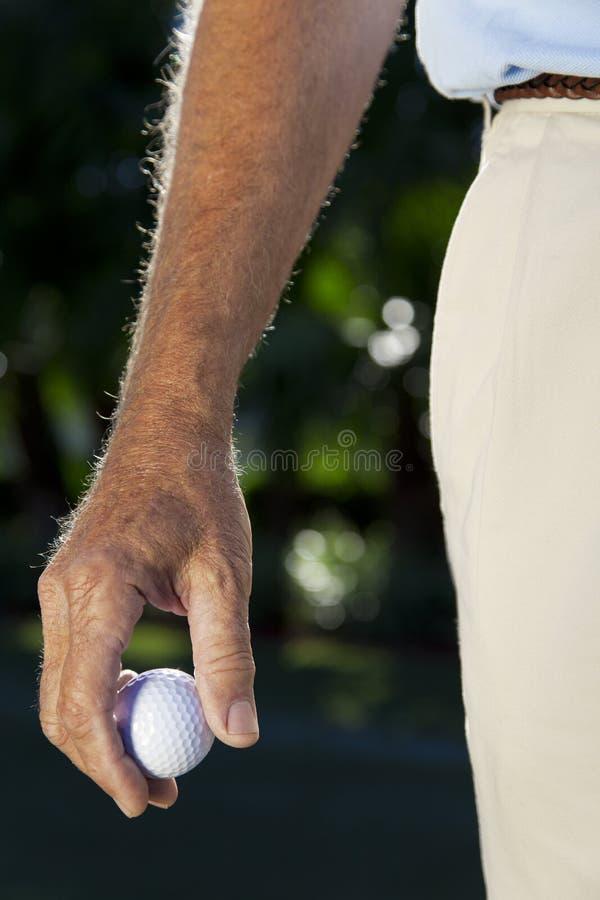 piłki golfowy golfisty mienie zdjęcia royalty free