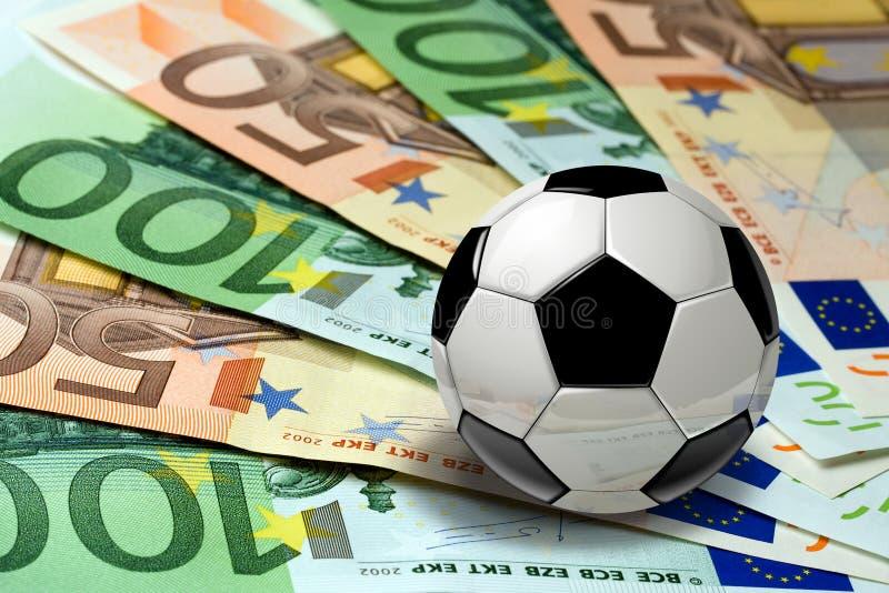 Piłki nożnej piłki banknotów euro pojęcie fotografia stock