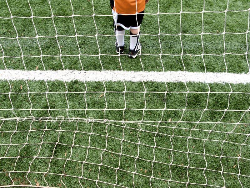 Piłki nożnej bramkarza chłopiec zdjęcia royalty free