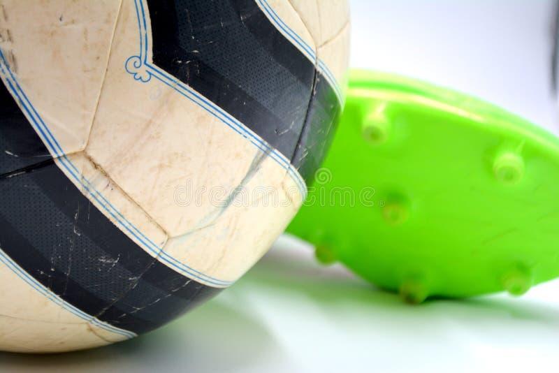 Piłki nożnej piłka buty fotografia stock